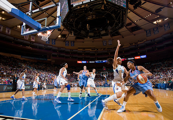 Plenette Pierson (#33) and the rest of the Liberty team defend against Angel McCoughtry and the Dream