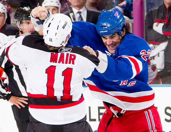 The Rangers' Brian Boyle fights with the Devils' Adam Mair
