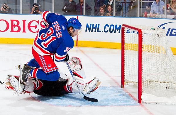 New York's Alexander Frolov scores a spectacular goal on New Jersey goaltender Martin Brodeur