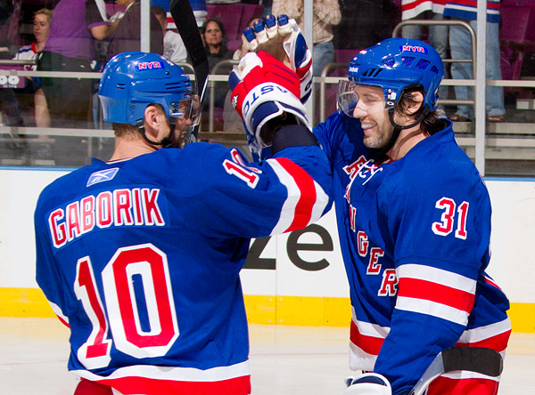 Frolov celebrates his goal with teammate Marian Gaborik