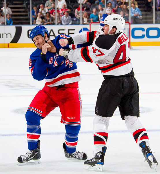 Brandon Prust dodges a punch from the Devils' Brad Mills