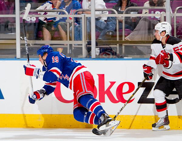 New York's Ruslan Fedotenko is tripped up by New Jersey's Mattias Tedenby