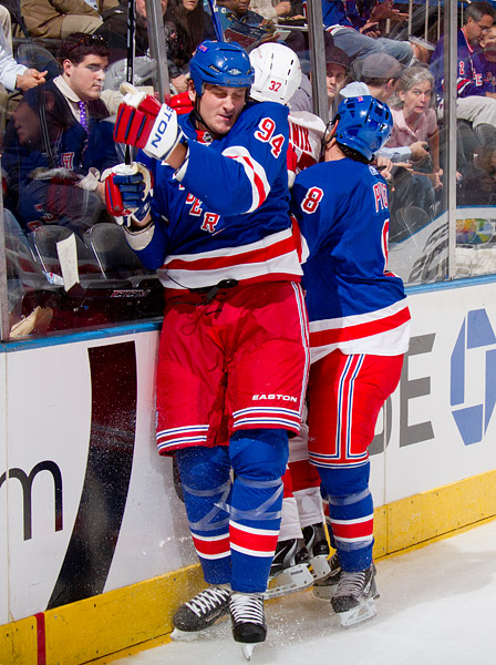 Rangers fourth-liners Derek Boogaard and Brandon Prust do their part in crushing Red Wings defenseman Doug Janik against the boards: