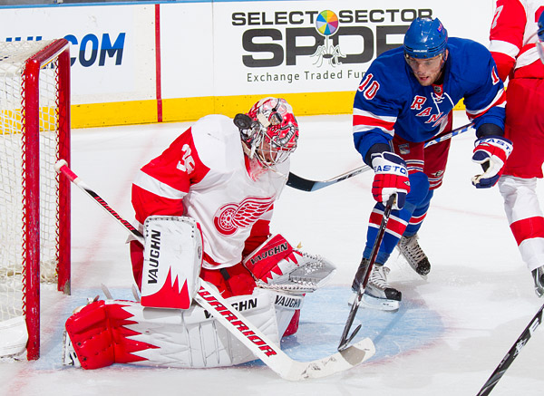 New York's Marian Gaborik attempts to deflect a shot past Detroit goaltender Jimmy Howard