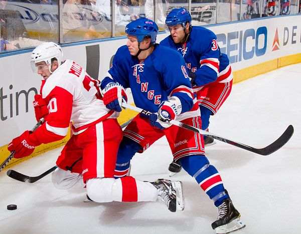 New York's Ruslan Fedotenko gets physical with Detroit's Drew Miller: