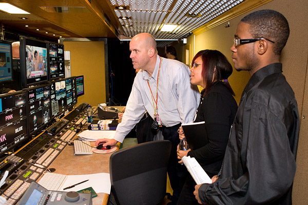 Students learn about video editing in the production truck