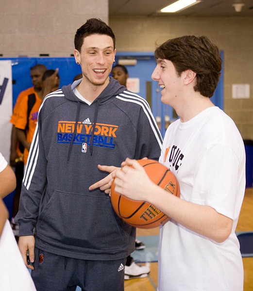 Andy Rautins chats with a player