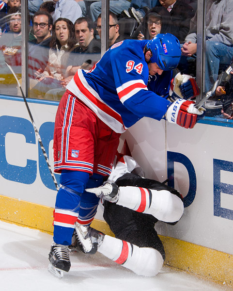 The Rangers' Derek Boogaard gets called for a boarding penalty for this hit