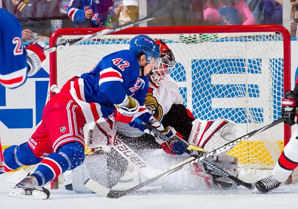 New York's Artem Anisimov attempts to score against Ottawa goaltender Brian Elliott