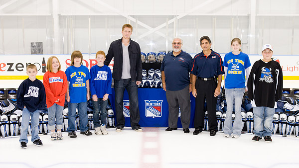 Marc Staal with local coaches and players