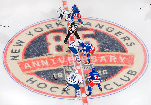 Opening faceoff on the Rangers' 85th anniversary logo. Chris Drury (center) and Marian Gaborik (top) left the game in the second period after sustaining injuries.