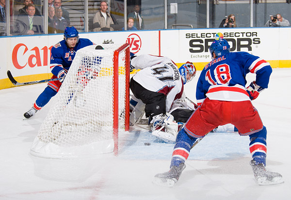 New York's Alex Frolov (left) scores his first goal as a Ranger