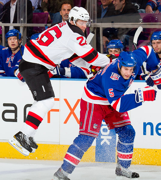 New York's Dan Girardi avoids a hit from an airborne Patrik Elias