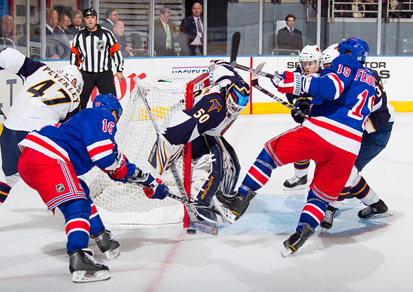 New York's Sean Avery and Ruslan Fedotenko try to get the puck past Atlanta goalie Chris Mason