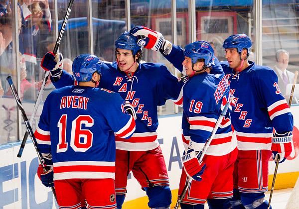 New York's Brian Boyle celebrates his third period goal with teammates Sean Avery, Ruslan Fedotenko and Michal Roszival