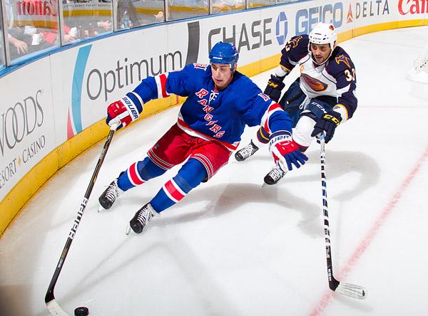 New York's Brandon Dubinsky plays keep away with Atlanta's Dustin Byfuglien