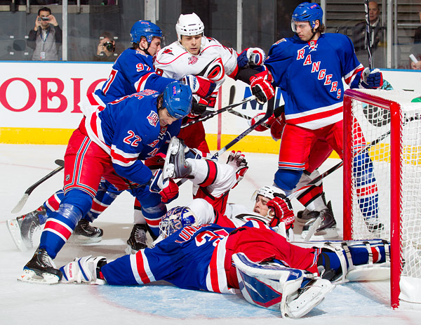 Rangers goalie Henrik Lundqvist dives on the puck after making one of his 34 saves