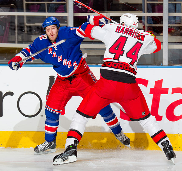 The Rangers' Brandon Prust and Hurricanes' Jay Harrison