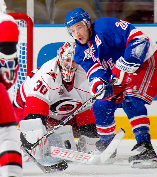 New York's Ryan Callahan tries to score a goal on Carolina goalie Cam Ward in the third period
