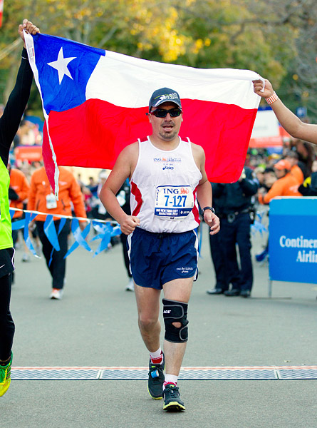 At about 3:30pm, Chilean miner Edison Peña crossed the finish line