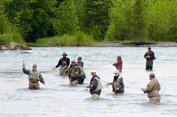 Fisherman hope to catch sockeye during the first of two annual salmon runs on the Kenai River