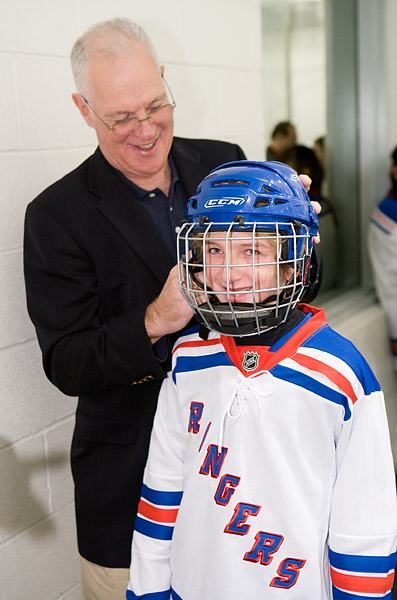 Dave Maloney, a former Rangers player (1974-1985) and current hockey analyst on MSG Network, helps out