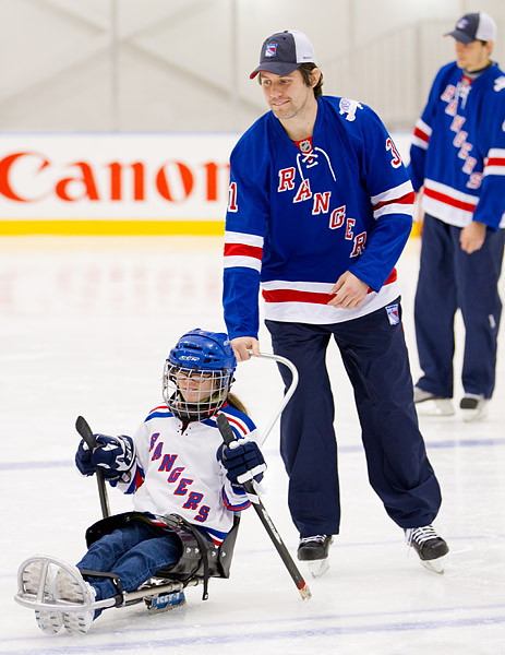 A girl gets a push from Rangers player Alex Frolov