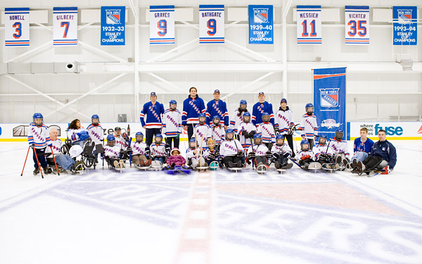New York Rangers skating and sled hockey