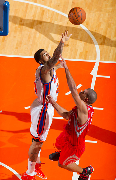 New York's Wilson Chandler blocks a shot by Houston's Shane Battier