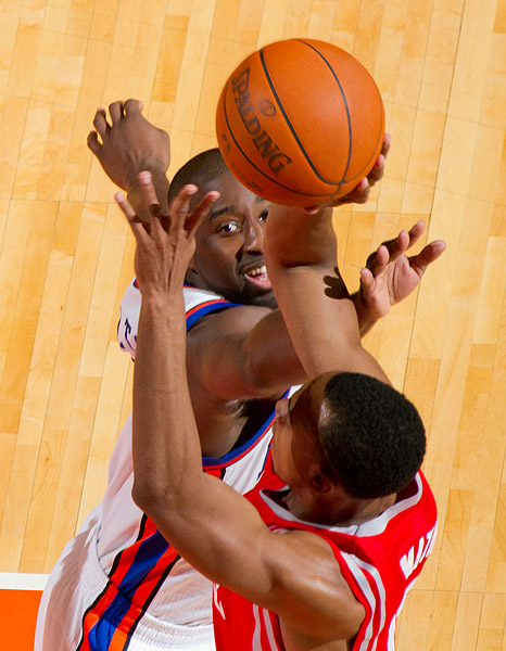 New York's Raymond Felton defends against Houston's Ishmael Smith