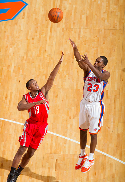 New York's Toney Douglas shoots over Houston's Ishmael Smith