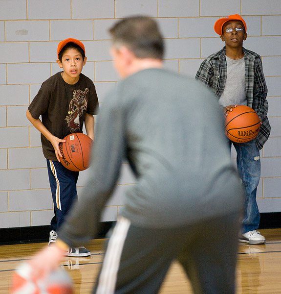 Assistant coach Phil Weber gives basketball pointers