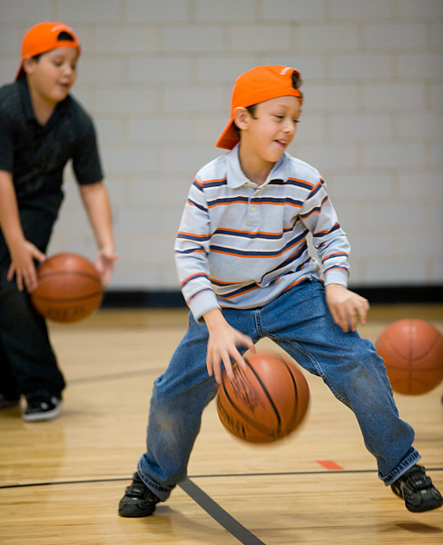 Kids practice their dribbling skills