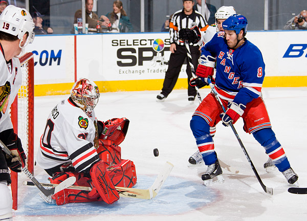 The Rangers' Brandon Prust attempts to score on Blackhawks goalie Marty Turco