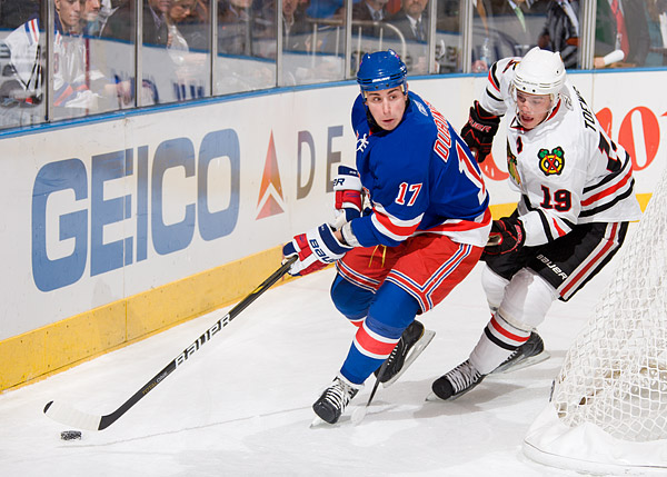 The Rangers' Brandon Dubinsky, who had two goals in the game, and Blackhawks captain Jonathan Toews