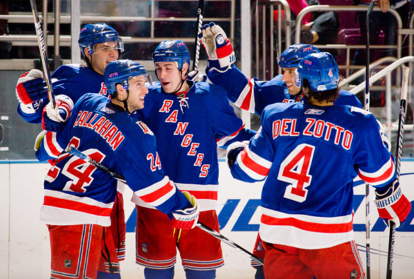 Brandon Dubinsky celebrates the second of his two goals with his teammates Artem Anisimov, Ryan Callahan, Michal Rozsival and Michael Del Zotto