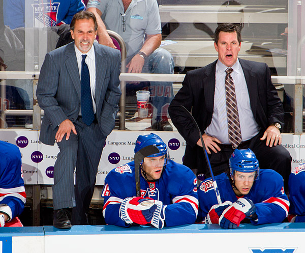 Rangers head coach John Tortorella and assistant coach Mike Sullivan react after a penalty is called against their defenseman Dan Girardi with 26 seconds left in the game. The penalty created a 2 man advantage for Chicago (because Chicago pulled their goalie for an extra attacker), but the Rangers survived their opponent's push for a tying goal.