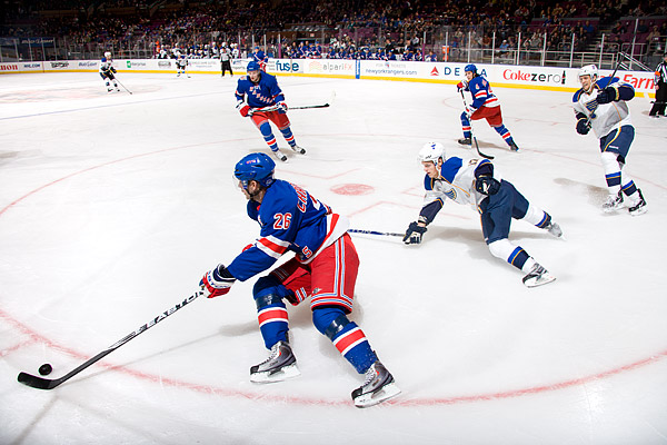 Erik Christensen and the Rangers take the puck out of their defensive zone