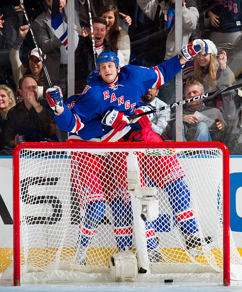 New York's Derek Boogaard celebrates scoring his first goal in nearly five years