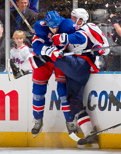 The Rangers' Brian Boyle checks the Capitals' John Erskine