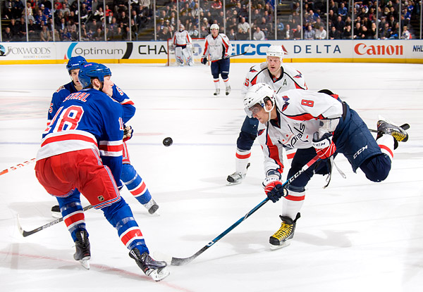 New York's Marc Staal attempts to block a shot by Washington's Alex Ovechkin