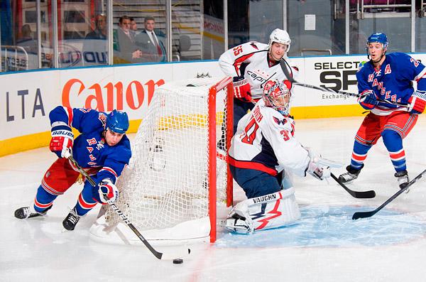 The Rangers' Brandon Dubinsky attempts a wrap-around goal against Capitals goalie Michal Neuvirth