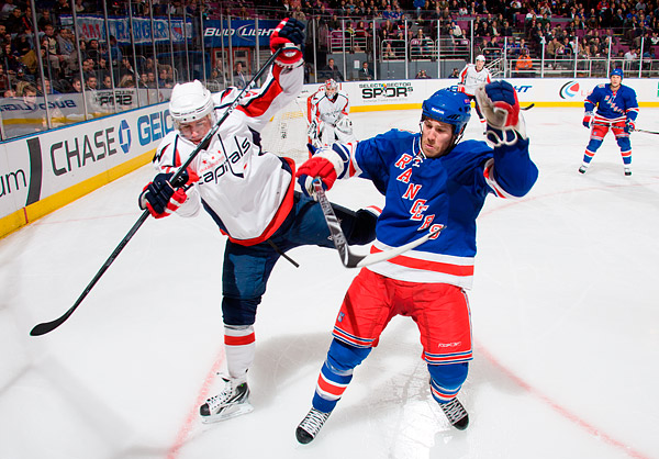 Washington's Mike Green and New York's Brandon Prust
