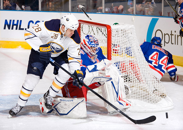 With Henrik Lundqvist out with flu-like symptoms, Rangers backup goalie Martin Biron was solid in net with 29 saves, including this one on the Sabres' Paul Gaustad