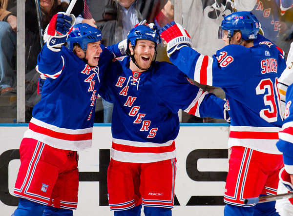 New York's Ruslan Fedotenko, Brandon Prust and Michael Sauer celebrate Fedotenko's first period goal