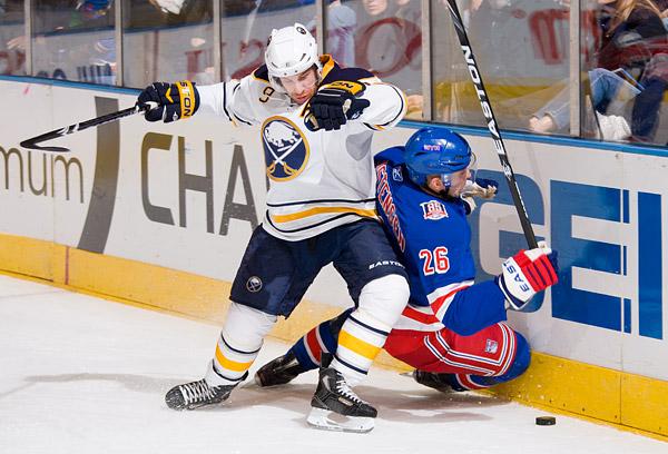 Buffalo's Derek Roy and New York's Erik Christensen battle for the puck
