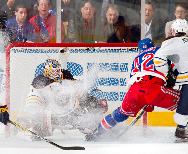 Sabres goalie Jhonas Enroth makes an overtime save on Artem Anisimov, who would score seconds later to win the game for the Rangers