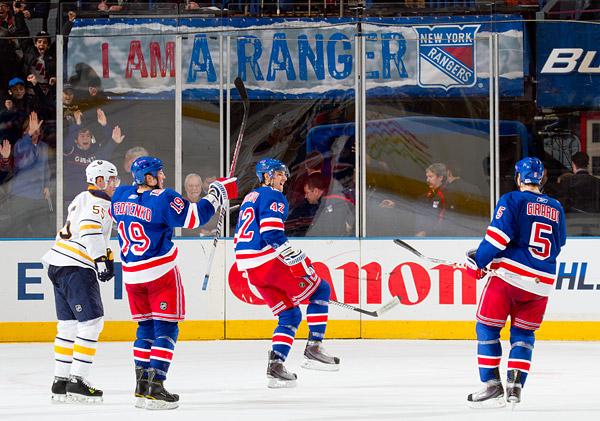 New York's Artem Anisimov (center) celebrates with Ruslan Fedotenko and Dan Girardi after scoring the overtime game-winning goal