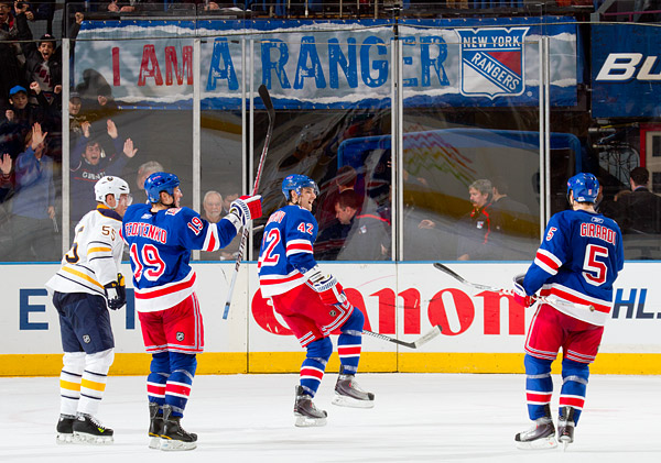 New York's Artem Anisimov (center) celebrates with Ruslan Fedotenko and Dan Girardi after scoring the overtime game-winning goal