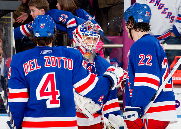 Rangers goalie Martin Biron celebrates the win with teammates Michael Del Zotto and Brian Boyle